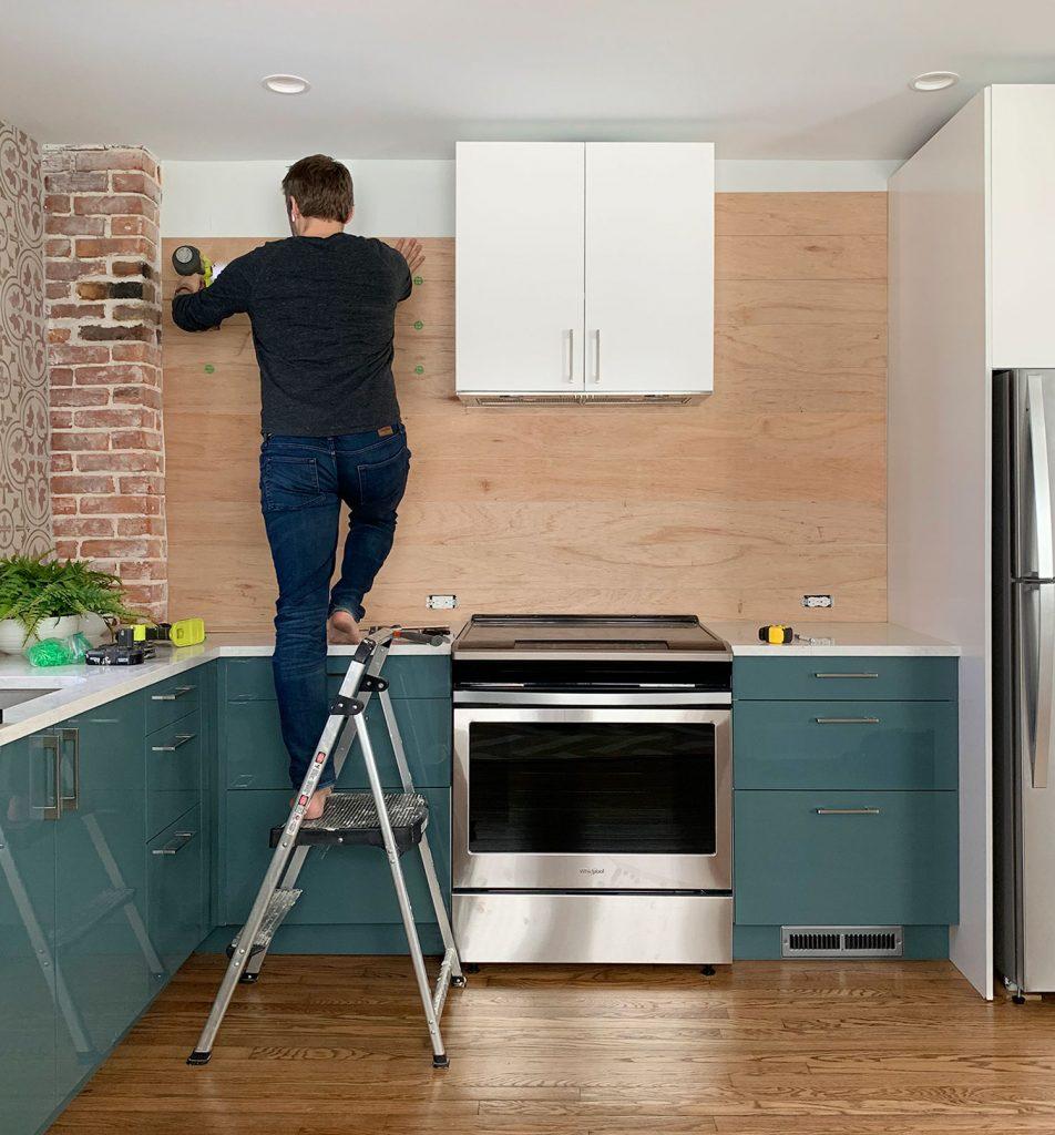 Kitchen Shiplap Backsplash John Nailing Boards 952x1024 - Installing A $31 Paneled Wall Treatment (Beginners Can Do This!)
