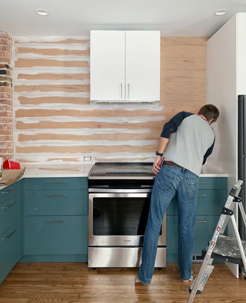 Kitchen Shiplap Backsplash John Painting Cracks 831x1024 - Installing A $31 Paneled Wall Treatment (Beginners Can Do This!)