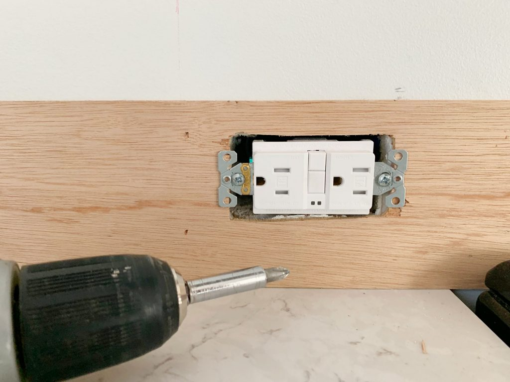 Electrical Outlet Screwed Back In Place Over Panel Strip