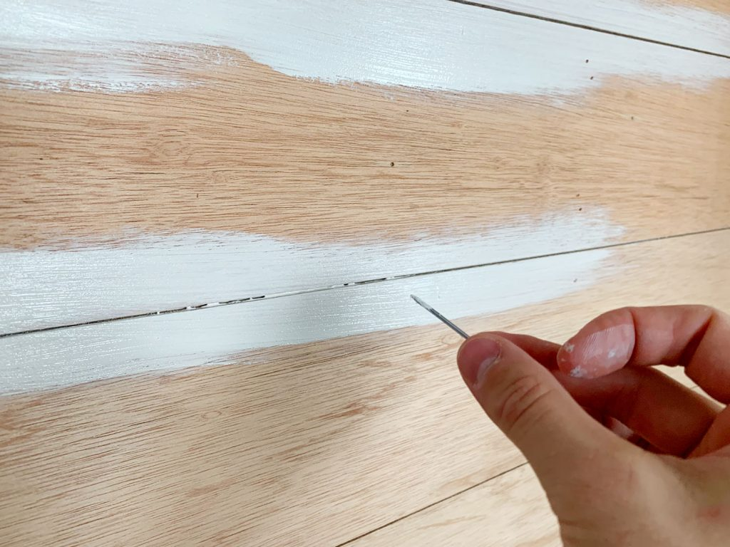 Kitchen Shiplap Backsplash Scraping Paint In Cracks 1024x768 - Installing A $31 Paneled Wall Treatment (Beginners Can Do This!)